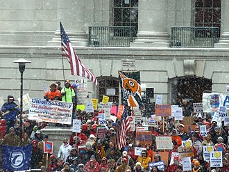 2011 Wisconsin protests - Demonstrators in steadily falling snow outside of the Wisconsin Capitol building