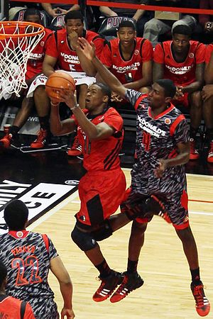 2013–14 Notre Dame Fighting Irish men's basketball team - Demetrius Jackson in front of Isaac Hamilton in the 2013 McDonald's All-American Boys Game