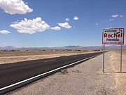 2014-07-18 13 11 09 Sign for and view of Rachel, Nevada from northbound Nevada State Route 375 about 38.5 miles north of Nevada State Route 318.JPG