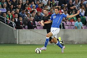 Adrien Silva - Silva contesting possession of the ball with Italy's Franco Vázquez in a June 2015 friendly