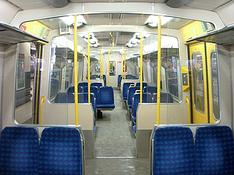 British Rail Class 313 - The interior of a London Overground Class 313/1. The seating capacity was reduced to 202 from 228 by the removal of most third seats to allow additional standing room.