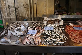 European pilchard - European pilchards, center right, are the cheapest thing for sale at this fish stall in Syracuse, Sicily