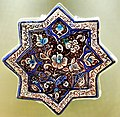 8-pointed star tile, luster technique, glazed. Ilkhanate period, 2nd half of the 13th century CE. From Kashan, Iran. Museum of Islamic Art (the Tiled Kiosk), Istanbul, Turkey.jpg