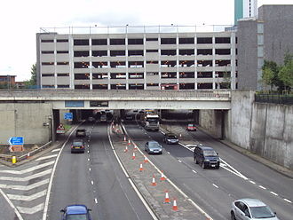 Leeds Inner Ring Road - Passing under the Woodhouse Lane multi-story car park.
