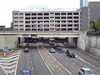 Leeds Inner Ring Road - Passing under the Woodhouse Lane multi-story car park.