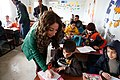 A Lebanese teacher lends a hand to Syrian children in Zaatari, Jordan.jpg
