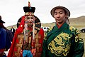 "A Man and Woman in Traditional Mongolian Dress Look on as Secretary Kerry Attends a ""Mini-Nadaam"" at a Field Outside of Ulaanbaatar (27442489122).jpg"