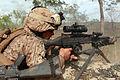 A U.S. Marine Corps machine gunner with Weapons Platoon, Lima Company, 3rd Battalion, 3rd Marine Regiment, Marine Rotational Force-Darwin fires an M240B machine gun during a night squad-attack exercise 130522-M-AL626-0704.jpg