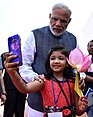 A child takes a selfie with Prime Minister Narendra Modi in Naya Raipur.jpg