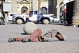 A homeless man sleeping in Cape Town.jpg