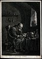 A scholar-alchemist pores over a book, searching for inspira Wellcome V0025543.jpg