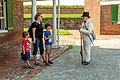 A soldier talks to visitors (276ee781-2c75-4388-bd39-f080ae3349d0).jpg