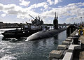 A tugboat assists the fast attack submarine USS Greeneville (SSN 772) approach the pier at Joint Base Pearl Harbor-Hickam, Hawaii 121214-N-DB801-041.jpg