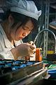 A worker assembling a digital camera in Ningbo.jpg