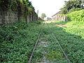 Abandoned Northrail rail tracks along Caloocan city, Philippines.JPG