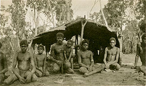 Groote Eylandt - Warnindhilyagwa men and boys in a bush shelter on Groote Eylandt, 1933