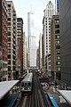 Adams Wabash L station, train, Trump International and downtown Chicago (49713266206).jpg