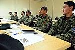Afghan airmen attend a literacy class at Kabul International Airport.jpg