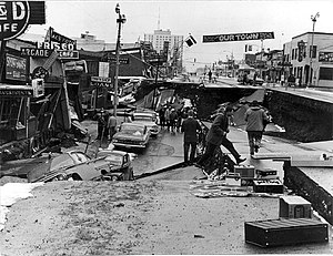 1964 Alaska earthquake - Fourth Avenue in Anchorage, Alaska, looking east from near Barrow Street. The southern edge of one of several landslides in Anchorage, this one covered an area of over a dozen blocks, including 5 blocks along the north side of Fourth Avenue. Most of the area was razed and made an urban renewal district.