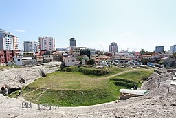 The amphitheatre of the city of Durrës and its port in the background.
