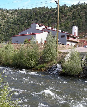 Argo Tunnel - The Argo Tunnel water treatment plant removes metals and acidity before the tunnel discharge flows into Clear Creek, in foreground.