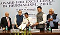 Arun Jaitley presenting the IPI INDIA Award for Excellence in Journalism, 2015 to Shri M. Shajil Kumar (Malayala Manorama), at a function, in New Delhi.jpg