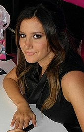 Head and shoulders of Tisdale in her twenties. Her dark brown, straight hair is parted to her left, and falls over her right ear.