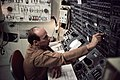 Astronaut Charles Conrad Jr. working with control panel in Skylab simulation.jpg