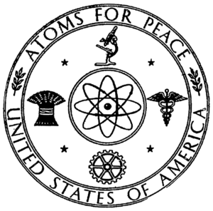 Atoms for Peace - The Atoms for Peace symbol mounted over the door to the American swimming pool reactor building during the 1955 International Conference on the Peaceful Uses of Atomic Energy in Geneva, often called the Atoms for Peace conference.