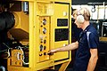 Aviation Support Equipment Technician E (Electrical) 2nd Class R. Smith tests out a mobile air conditioning unit outside an Aircraft Intermediate Maintenance Department (AIMD) shop - DPLA - 4c5521584a986e49e24f9087f5eb7dbb.jpeg