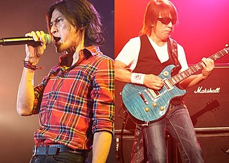 B'z - Koshi Inaba (left) and Tak Matsumoto (right) performing in 2012