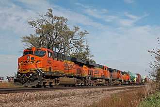BNSF Railway - BNSF ES44DC 7402 leads a train of Boeing 737 fuselages at Greenwood, Nebraska in October 2014.