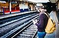 Backpacker waiting for the train (Unsplash).jpg