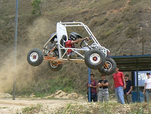 Baja SAE -  Picture of the UCAB vehicle navigating a jump at the test track La Limonera in Caracas, Venezuela in preparation for the 2007 Baja Midwest event in Rochester, NY