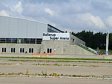 "The outside of the arena bearing the title ""Ballerup Super Arena"""