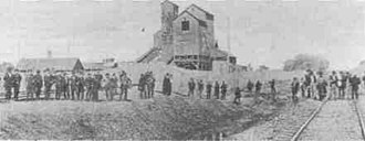 Illinois coal wars - Miners gathering at the railroad tracks in Virden on October 12, 1898.
