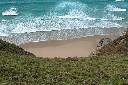 Water waves are almost parallel to the beach when they hit it because they gradually refract towards land as the water gets shallower. Beach and waves (2784111859).jpg