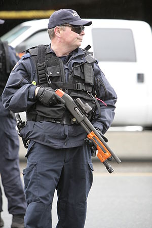 Bean bag round - A RCMP officer in 2010 armed with a shotgun outfitted to fire beanbag rounds