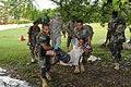 Belize Defence Force combat medics, Lance Cpl. Leon Lopez, left, and Cpl. Paul Shal carry a volunteer field casualty to a safe area, while being observed by Belize Defence Force and U.S. Army trainers, during 100830-A-CL600-087.jpg