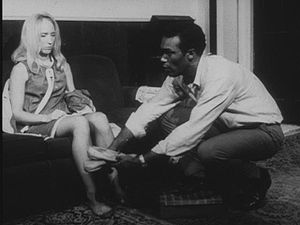 Ben giving Barbra slippers in Night of the Living Dead bw.jpg