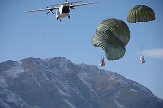 Academi - Blackwater CASA 212 over Afghanistan dropping supplies to U.S. Army soldiers