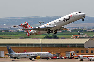 Seville Airport - Boeing 717-200 of Volotea takes off with aircraft of Vueling and Iberia regional in the background.