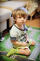 Boy is sitting on the floor. (7080050877).jpg