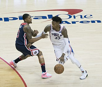 Robert Covington - Covington drives against Bradley Beal in 2018