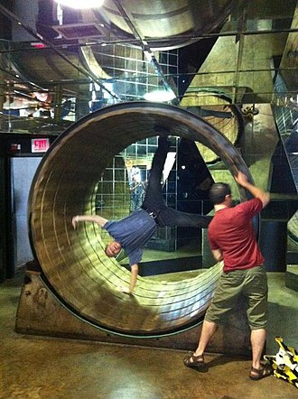 Brian Dunning (author) - Brian Dunning in the giant hamster wheel at the College of Curiosity in 2012, City Museum, St. Louis MO