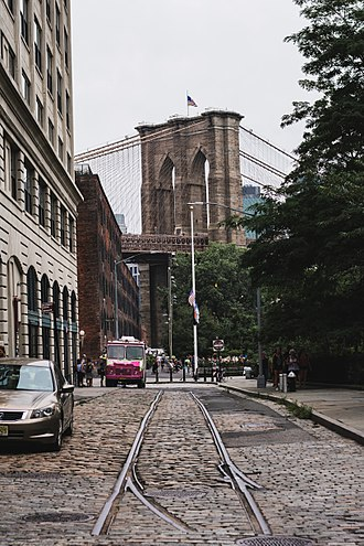 Brooklyn Bridge - Looking down a neighboring street at the large bridge.