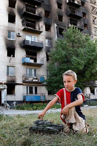 Damaged tower block in Lysychansk, 28 July 2014 Burned apartment building in Lysychansk, July 28, 2014.jpg