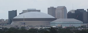 Sports in New Orleans - Mercedes-Benz Superdome (left) and the Smoothie King Center (right)