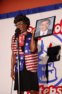 Woman holding a picture of Barack Obama