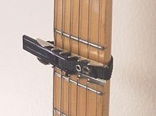 Capo on a guitar neck.jpg